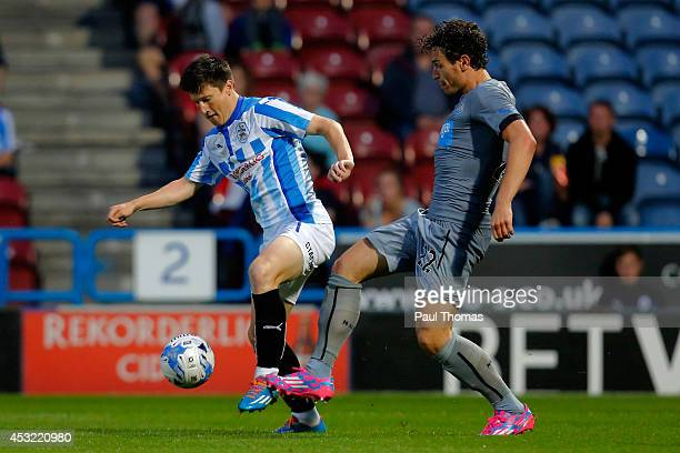 Joe Lolley of Huddersfield in action with Daryl Janmaat of Newcastle during the Pre Season Friendly match between Huddersfield Town and Newcastle...