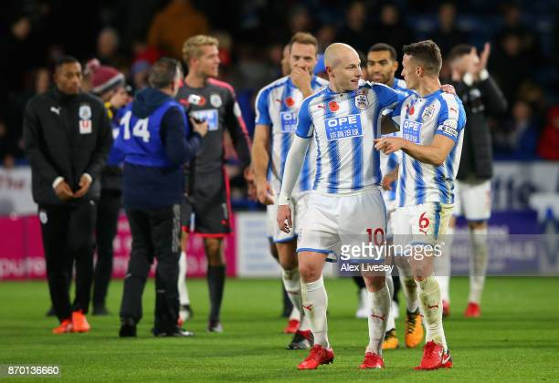 Joe Lolley of Huddersfield Town and Jonathan Hogg of Huddersfield Town celebrates after the Premier League match between Huddersfield Town and West...