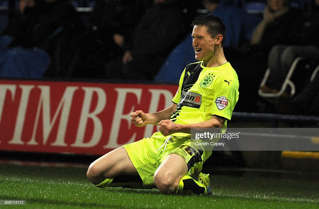 Joe Lolley of Huddersfield Town celebrates scoring the opening goal during the Sky Bet Championship match between Bolton Wanderers and Huddersfield Town at the Macron Stadium on January 2, 2016 in Bolton, United Kingdom.