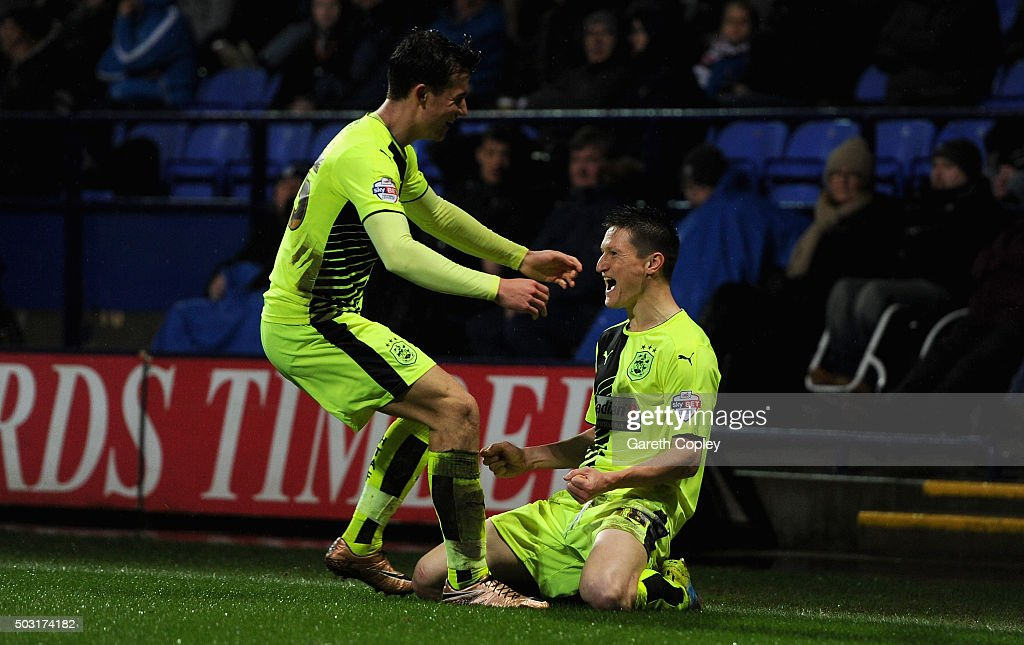 Joe Lolley of Huddersfield Town celebrates scoring the opening goal with Ben Chilwell during the Sky Bet Championship match between Bolton Wanderers and Huddersfield Town at the Macron Stadium on January 2, 2016 in Bolton, United Kingdom.