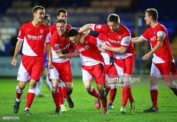 Joe Lolley of Kidderminster Harriers is congratulated by team mates as he scores their third goal during the FA Cup with Budweiser Third round replay...