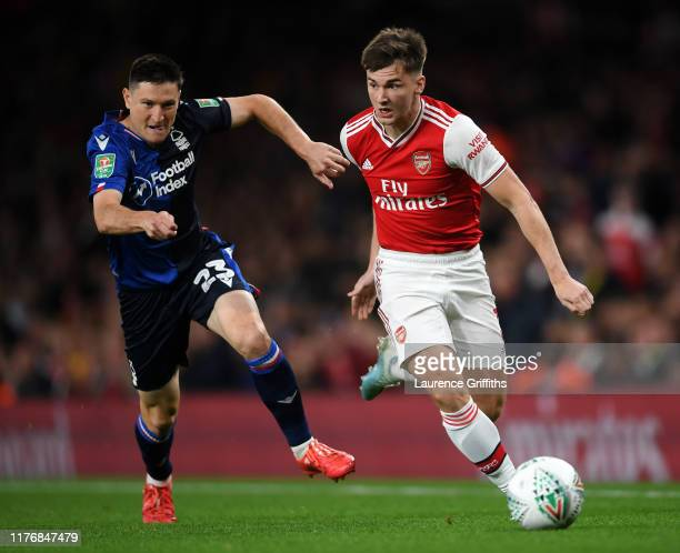 Joe Lolley of Nottingham Forest battles for the ball with Kieran Tierney of Arsenal during the Carabao Cup Third Round match between Arsenal FC and...