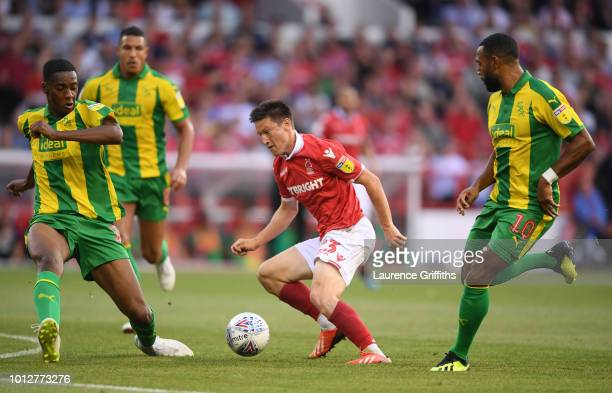 Joe Lolley of Nottingham Forest battles with Oluwatosin Adarabioyo and Matt Phillips of West Bromwich Albion during the Sky Bet Championship match...
