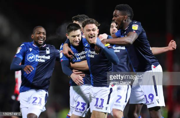 Joe Lolley of Nottingham Forest celebrates with team mates after scoring his team's first goal during the Sky Bet Championship match between...