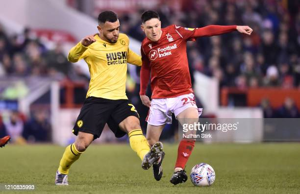 Joe Lolley of Nottingham Forest is put under pressure Mason Bennett by of Millwall during the Sky Bet Championship match between Nottingham Forest...