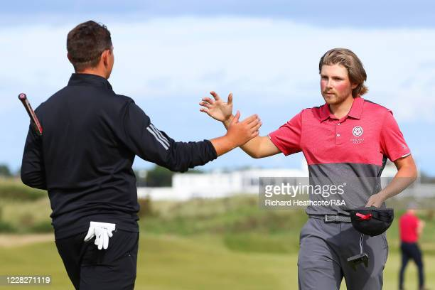 Joe Long of England is congratulated on the 15th green by Joe Harvey on his 4&3 victory in the afternoon round during the Final on Day Six of the...