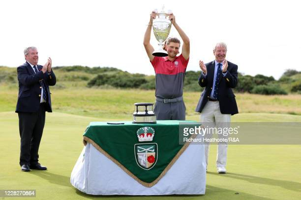 Joe Long of England lifts the trophy following his 4&3 victory during the Final on Day Six of the Amateur Championship at Royal Birkdale on August...