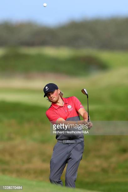 Joe Long of England pitches on the 15th hole in the afternoon round during the Final on Day Six of the Amateur Championship at Royal Birkdale on...