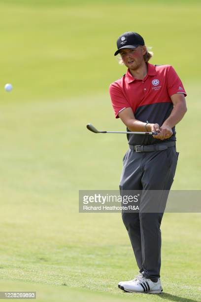 Joe Long of England pitches on the 8th hole in the afternoon round during the Final on Day Six of the Amateur Championship at Royal Birkdale on...