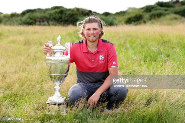 Joe Long of England poses with the trophy following his 4&3 victory during the Final on Day Six of the Amateur Championship at Royal Birkdale on...