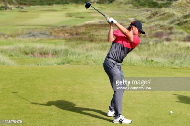 Joe Long of England tees off on the 13th hole in the afternoon round during the Final on Day Six of the Amateur Championship at Royal Birkdale on...
