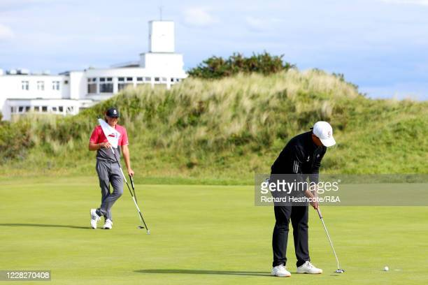 Joe Long of England watches Joe Harvey putt on the 14th green in the afternoon round during the Final on Day Six of the Amateur Championship at Royal...