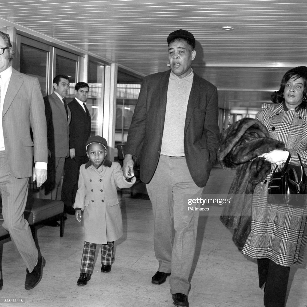 timeless design a7bad 1da1d Joe Louis and his son Jo Jo on arrival at Heathrow Airport ...