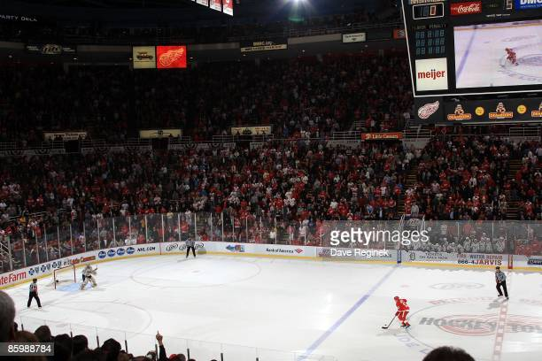 Joe Louis Arena crowd stands to their feet as Pavel Datsyuk of the Detroit Red Wings skates in for his shootout attempt on goaltender Pekka Rinne of...