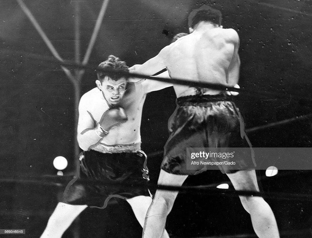 Joe Louis defeating Jim Braddock at Comiskey Park, Chicago, Illinois, June 22, 1937.