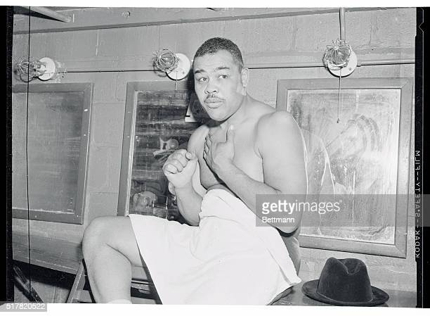 Joe Louis is shown is his dressing room after his first venture as a pro wrestler proved successful Louis defeated Don Cowboy Rocky Lee in 11 minutes...