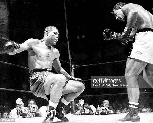 Joe Louis is sinking to the canvas as Rocky Marciano watches at Madison Square Garden