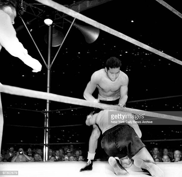 Joe Louis versus Max Schmeling II Knockdown No 1 Max plunges to the canvas propelled by the batteringram socks of the Tan Tornado