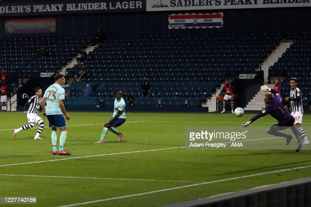 Joe Lumley of Queens Park Rangers parries the shot on goal from Filip Krovinovic of West Bromwich Albion during the Sky Bet Championship match...