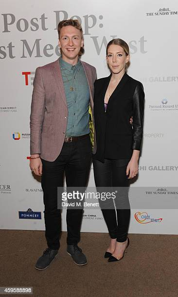 Joe Lycett and Katherine Ryan attends a private view of Post Pop East Meets West at The Saatchi Gallery on November 25 2014 in London England