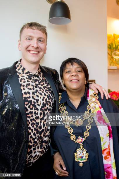 Joe Lycett and Lord Mayor of Birmingham Councillor Yvonne Mosquito at the opening of Joe Lycett's new kitchen extension at his home on May 14 2019 in...