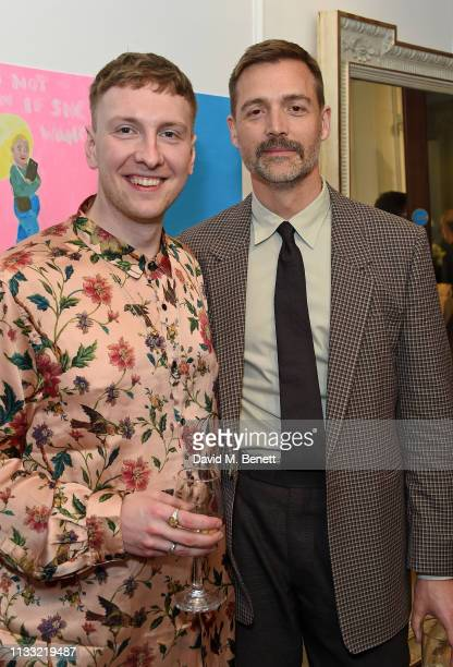 Joe Lycett and Patrick Grant attend a private view of Lycett Son an exhibition of works by comedian Joe Lycett and his mother Helen Lycett hosted by...