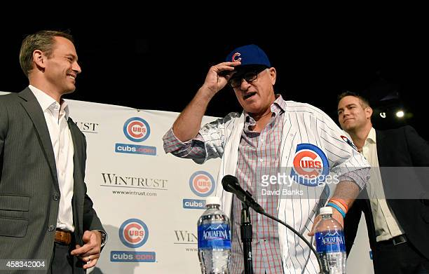 Joe Maddon is introduced as the Chicago Cubs new manager with Cubs President Theo Epstein and General Manager Jed Hoyer during a press conference on...