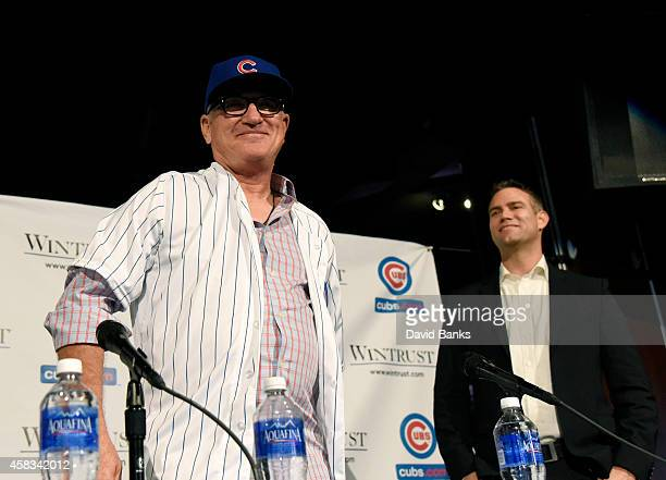 Joe Maddon is introduced as the Chicago Cubs new manager with Cubs President Theo Epstein during a press conference on November 3 2014 in Chicago...