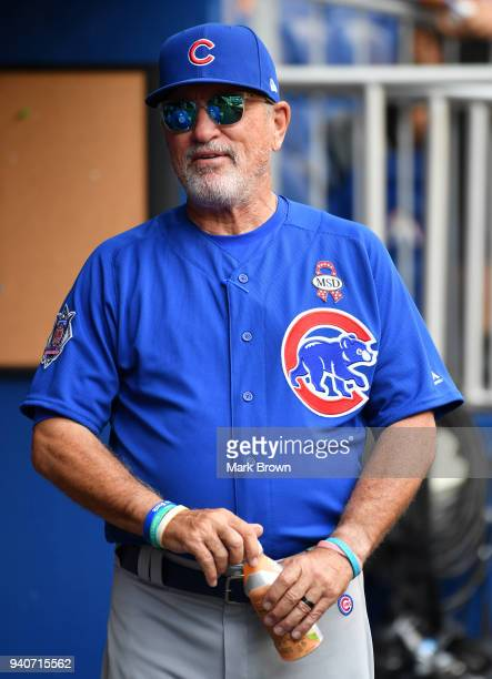 Joe Maddon of the Chicago Cubs in the dugout before the game against the Miami Marlins at Marlins Park on April 1 2018 in Miami Florida