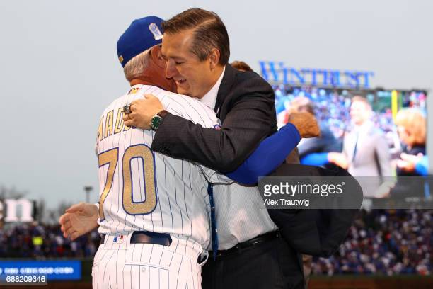 Joe Maddon of the Chicago Cubs is greeted by Cubs Owner Tom Ricketts during the World Series ring ceremony ahead of the game between the Los Angeles...