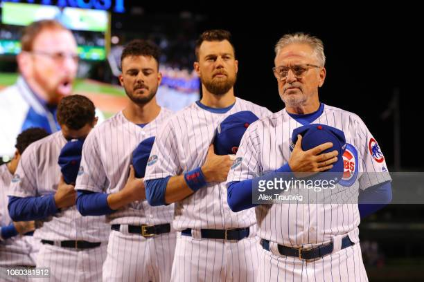 Joe Maddon of the Chicago Cubs lines up for the national anthem before the National League Wild Card game against the Colorado Rockies at Wrigley...