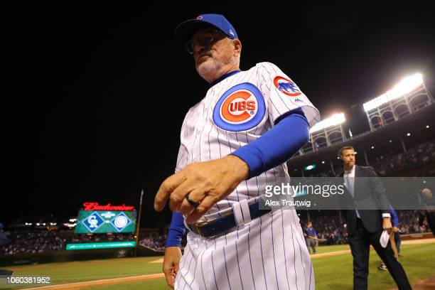 Joe Maddon of the Chicago Cubs returns to the dugout after the national anthem before the National League Wild Card game against the Colorado Rockies...
