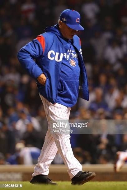 Joe Maddon of the Chicago Cubs returns to the dugout during the National League Wild Card game against the Colorado Rockies at Wrigley Field on...