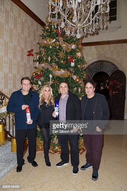 Joe Maloof, Adrienne Maloof, Gavin Maloof and George Maloof attend Adrienne Maloof's Annual Holiday Party with Never Too Hungover on December 24,...