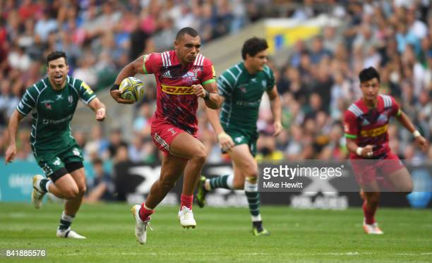 Joe Marchant of Harlequins breaks through to score their first try during the Aviva Premiership match between London Irish and Harlequins at...