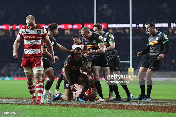 Joe Marchant of Harlequins celebrates scoring his team's third try during the Aviva Premiership Big Game 9 match between Harlequins and Gloucester...