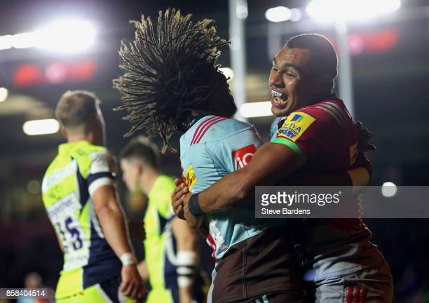 Joe Marchant of Harlequins celebrates with Marland Yarde after scoring a try during the Aviva Premiership match between Harlequins and Sale Sharks...