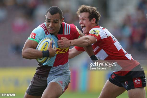 Joe Marchant of Harlequins is tackled by Billy Burns of Gloucester Rugby during the Aviva Premiership match between Harlequins and Gloucester Rugby...