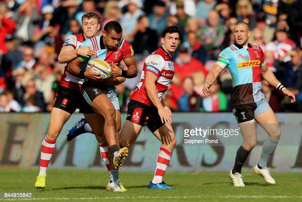 Joe Marchant of Harlequins is tackled during the Aviva Premiership match between Harlequins and Gloucester Rugby at Twickenham Stoop on September 9...
