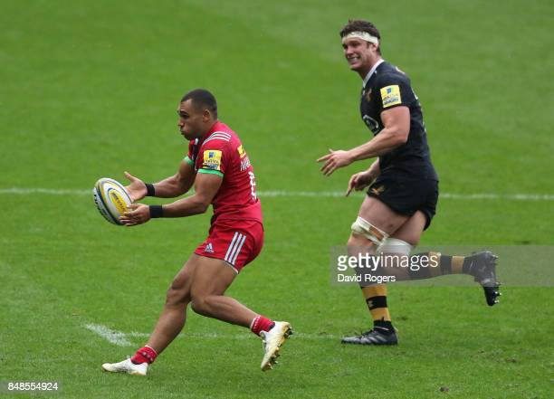 Joe Marchant of Harlequins passes the ball during the Aviva Premiership match between Wasps and Harlequins at The Ricoh Arena on September 17 2017 in...