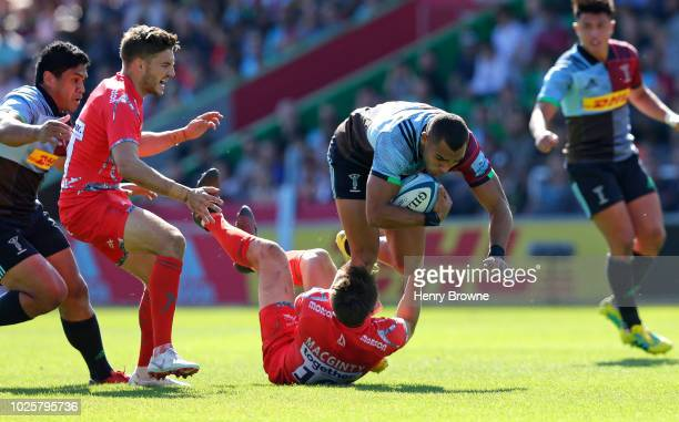 Joe Marchant of Harlequins tackled by AJ MacGinty of Sale Sharks during the Gallagher Premiership Rugby match between Harlequins and Sale Sharks at...