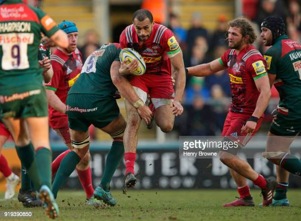 Joe Marchant of Harlequins tackled by Graham Kitchener of Leicester Tigers during the Aviva Premiership match between Leicester Tigers and Harlequins...