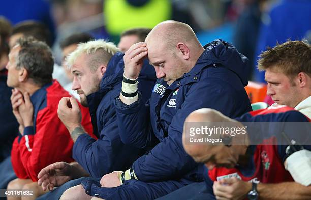 Joe Marler and Dan Cole of England hold their heads in their hands on the replacements bench during the 2015 Rugby World Cup Pool A match between...