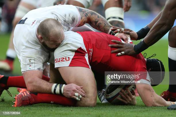 Joe Marler of England collides with the back end of Leigh Halfpenny of Wales during the 2020 Guinness Six Nations match between England and Wales at...