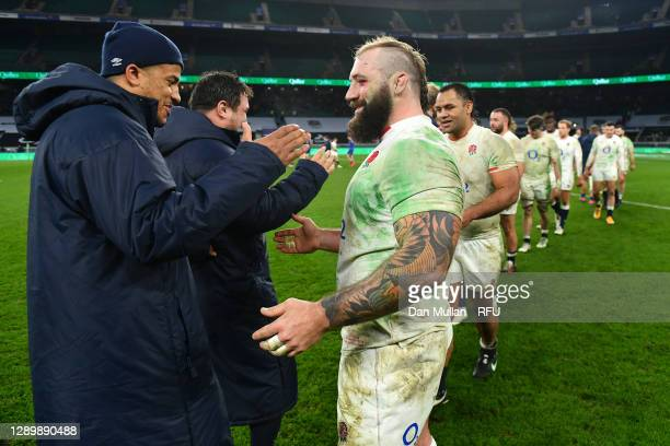 Joe Marler of England embraces Anthony Watson of England following their side's victory during the Autumn Nations Cup Final & Quilter International...