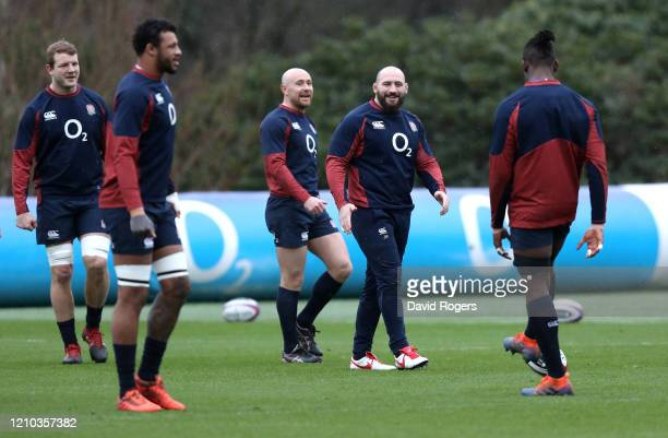 Joe Marler of England laughs during a training session ahead of their Guinness Six Nations match against Wales at Pennyhill Park on March 04 2020 in...