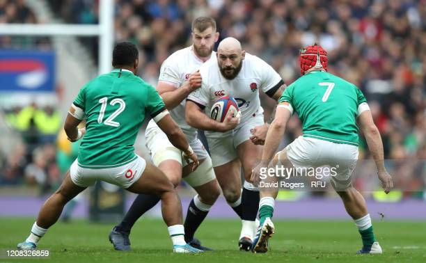 Joe Marler of England takes on Bundee Aki and Josh van der Flier during the 2020 Guinness Six Nations match between England and Ireland at Twickenham...