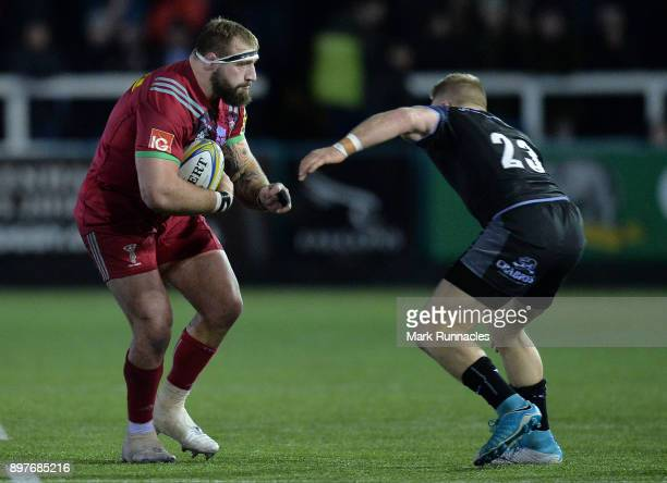 Joe Marler of Harlequins is tackled by Alex Tait of Newcastle Falcons during the Aviva Premiership match between Newcastle Falcons and Harlequins at...