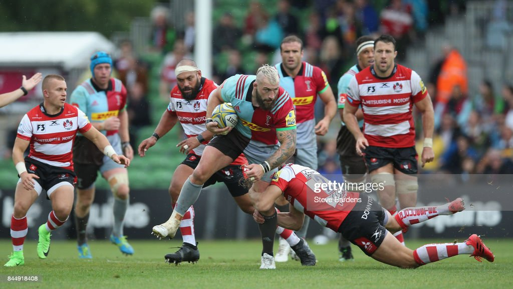 Joe Marler of Harlequins is tackled by Billy Twelvetrees of Gloucester Rugby during the Aviva Premiership match between Harlequins and Gloucester Rugby at Twickenham Stoop on September 9, 2017 in London, England.