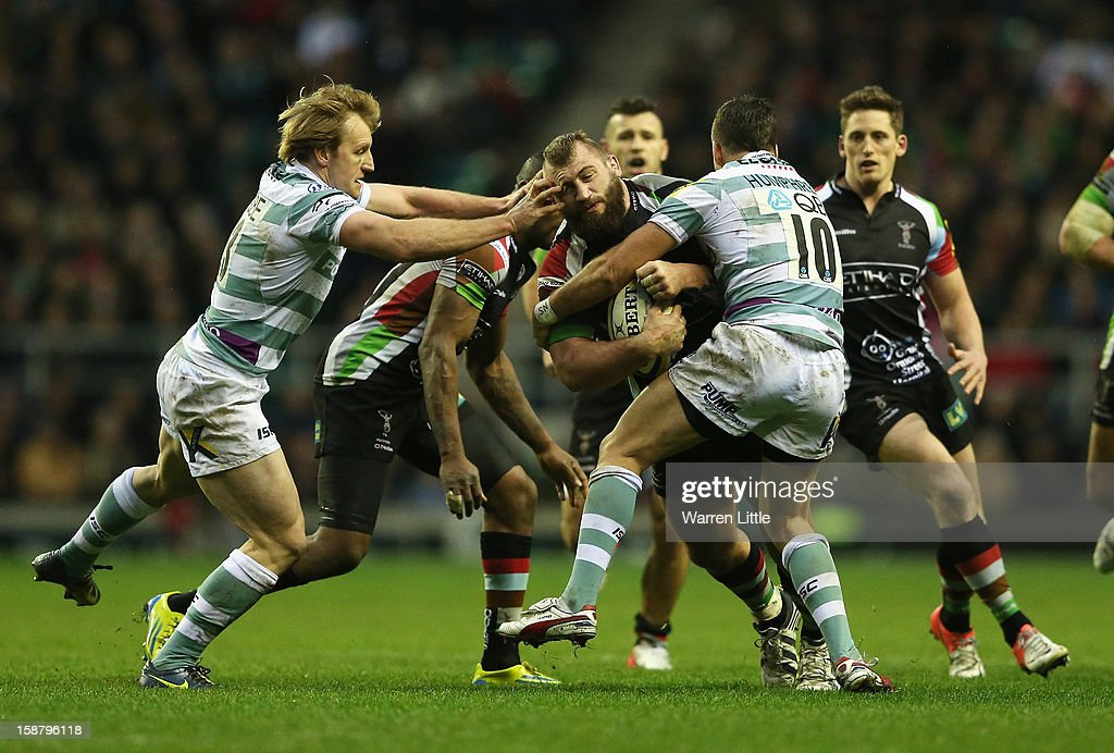 Joe Marler of Harlequins is tackled by Ian Humphreys (R) and Patrick Phibbs of London Irish during the Aviva Premiership match between Harlequins and London Irish at Twickenham Stadium on December 29, 2012 in London, England.